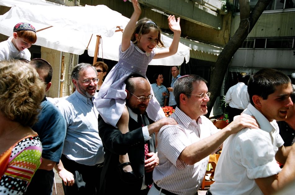people dancing during a Jewish Wedding